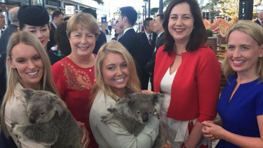 Premier Annastacia Palaszczuk, Tourism Minister Kate Jones, right, and Brisbane Airport Corporation chief executive Julieanne Alroe, back left, mark the first-ever direct flights between Shanghai and Brisbane with Australia Zoo koala handlers Jess Sullivan and Becky-Jo Quinn.