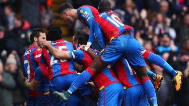 Joe Ledley is mobbed by Palace teammates after scoring against Liverpool.