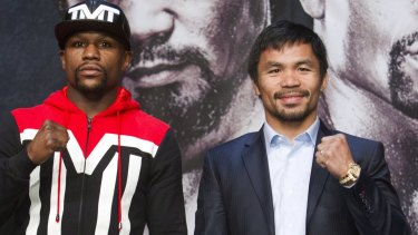 Payday ... Undefeated WBC/WBA welterweight champion Floyd Mayweather Jr (left) of the US and WBO welterweight champion Manny Pacquiao of the Philippines pose during a final news conference at the MGM Grand Resort in Las Vegas, Nevada.