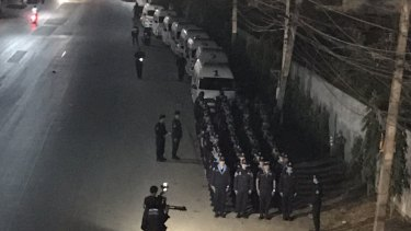 Columns of police form part of the stand-off at the temple.