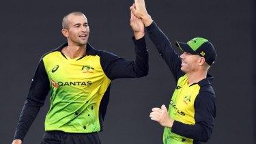Team spirit: T20 captain David Warner high fives Ashton Agar after the bowler dismissed Tim Siefert.
