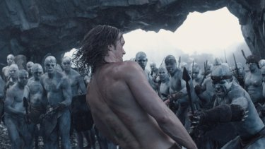 Alexander Skarsgard (back to camera) in the film The Legend of Tarzan.