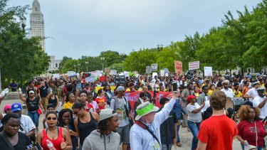 Protesters march to the state capitol in Baton Rouge, Louisiana, on Sunday.