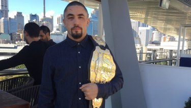 The champ is here: Robert Whittaker poses with the interim middleweight title.