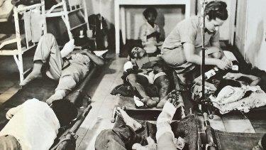 Another Australian civilian nurse, Maureen Spicer, at work at Bien Hoa Provincial Hospital north-east of Saigon in 1966.