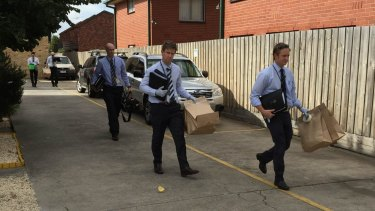 Homicide detectives seize evidence from Sean Price's flat.