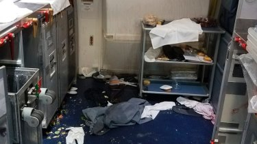 A photo taken by the FBI shows the aftermath of a cabin on Delta Flight 129 from Seattle to Beijing.