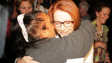 Prime Minister Julia Gillard is hugged after she offered the National Apology for Forced Adoptions in the Great Hall at Parliament House in Canberra.