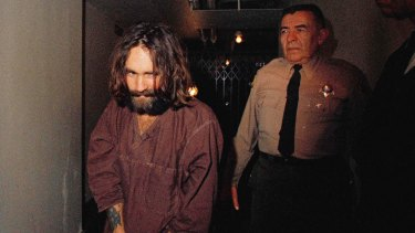Charles Manson is escorted to court in Los Angeles during an arraignment phase in 1969.