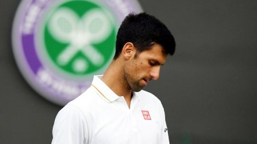 Novak Djokovic looking dejected during his third round match against Sam Querry.