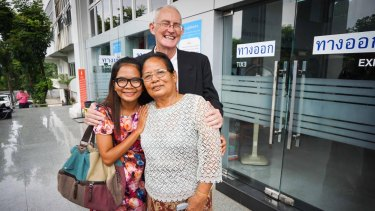 Alan Morison and Chutima Sidasathian with family and supporters after their acquittal.