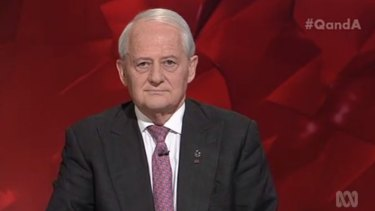 Senior Coalition MP Philip Ruddock wore his Amnesty International badge with pride and was confronted by US academic Cornel West over Australia's immigration policy.