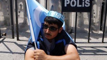 A Uighur protester demonstrates outside the Thai embassy in Ankara, Turkey, in June.