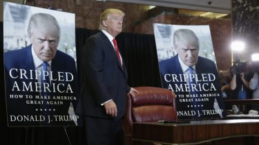 Republican presidential candidate Donald Trump arrives to autograph copies of his new book.