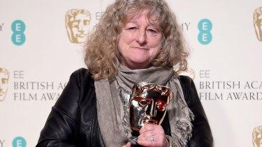 Eye of the storm: Costume designer Jenny Beavan with her BAFTA.