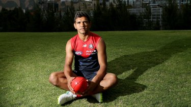 Melbourne footballer Neville has signed a new contract with the club.