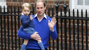 It's a girl: William, the Duke of Cambridge and his son Prince George wave outside St. Mary's Hospital's Lindo Wing on Saturday.