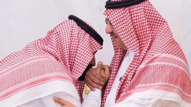 Newly appointed Saudi Arabian crown prince Mohammed bin Salman (left) kisses the hand of former heir Mohammed bin Nayef.
