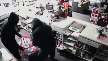 Police believe the same two men have carried out a series post office robberies worth more than $300,000.