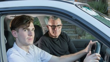 """P-plate driver Reilly King, 17, with his father Adrian, says his mother has been talking to him about driving safely for """"at least five years""""."""
