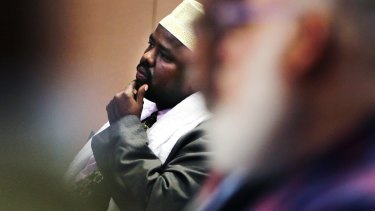 """Mahdi Ahmed Ali, vice president of the Somali Council of New England, listens to a video as part of the """"Countering Violent Extremism"""" program in 2015."""