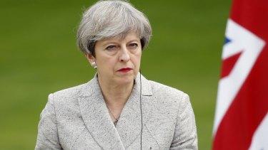 Saddened: British Prime Minister Theresa May.
