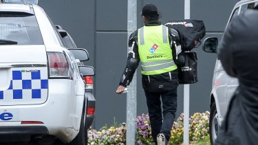 A Domino's Pizza deliveryman delivers an order to the centre on Monday aternoon.