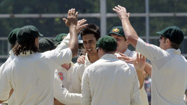 Glory day: Australia's Mitchell Johnson celebrates his 8th wicket against South Africa.