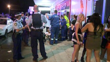 Police and the ambulance attend to the victim of a one-punch assault in St Marys on Saturday evening.