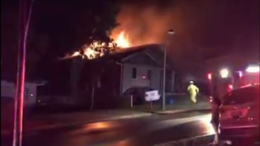 The four occupants had barricaded themselves in the bathroom before the house was ablaze.