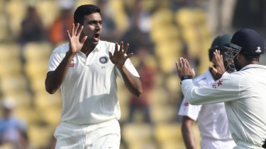 Indian spinner Ravichandran Ashwin, center, celebrates with teammates after claiming the wicket of South African captain Hashim Amla on the second day of the third cricket test match between the two countries in Nagpur, India, Thursday, Nov. 26, 2015. (AP Photo/Rafiq Maqbool)