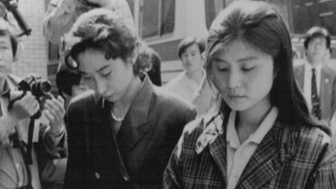 Confessed North Korean agent Kim Hyon-hui, right, enters court during her trial..Kim was sentenced to death for the 1987 bombing of a South Korean airliner, killing 115 people on board.