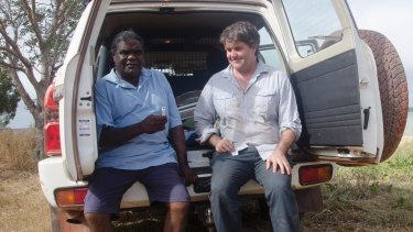 Biological anthropologist Michael Westaway from Griffith University obtains a saliva sample from Thanakwith elder Thomas Wales in Cape York.