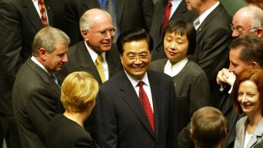 October 2003: Jiang's successor, Chinese president Hu Jintao, is congratulated by prime minister John Howard, opposition leader Simon Crean and MPs including future PM Julia Gillard after his address to a joint sitting of Australia's parliament.