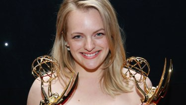 """Elisabeth Moss with her awards for outstanding lead actress in a drama series and outstanding drama series for """"The Handmaid's Tale"""" at the 69th Primetime Emmy Awards in 2017."""