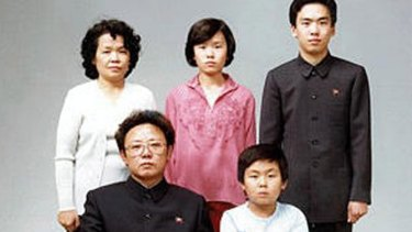 North Korean leader Kim Jong-il, seated, in 1981. First-born son Kim Jong-nam is bottom right.