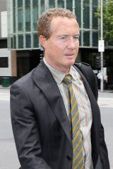 Police officer Timothy Baker outside Melbourne Magistrates Court on Wednesday.
