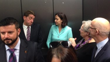 Queensland health minister Cameron Dick discussing health funding with premier Annastacia Palaszczuk in the lift at the Princess Alexandra Hospital.
