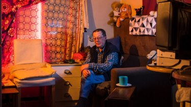 """""""Life has been up and down for me"""": Clive, 67, sits in his Waterloo flat."""