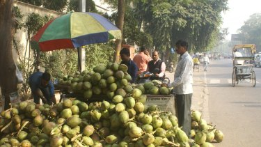 """Coconut water seller Mohan Kishore says the cash crisis has made it hard for him to pay his suppliers but he feels the hardship is worth it for the """"punishment"""" of the rich."""