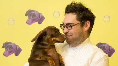 Artist David Capra and his dog, Teena.