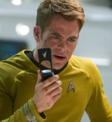 Chris Pine as Captain Kirk, using his very 90s flip-phone-like communicator.