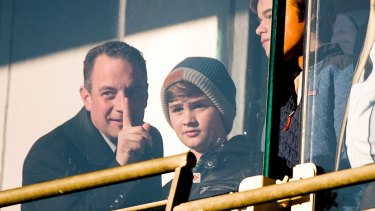 Trump Chief of Staff Reince Priebus, left, and his son Jack, right, watch an Army-Navy college football game in Baltimore.
