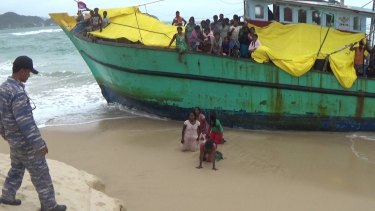 The Sri Lankan women disembark the boat against the orders of the Indonesian authorities.