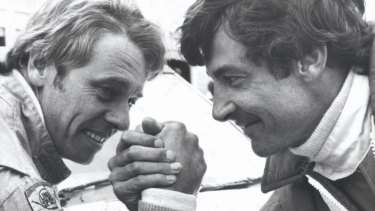 Peter Brock and Dick Johnson in an arm wrestle.