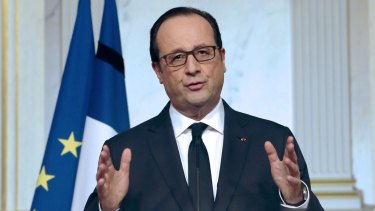 French President Francois Hollande addresses the media at the Elysee Palace on Friday.