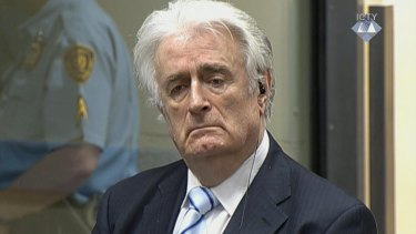 Radovan Karadzic listens as he is convicted of genocide in The Hague.