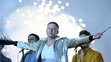 Macklemore performs during the NRL grand final.