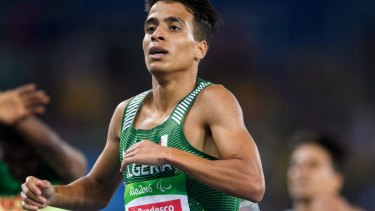 Algeria's Abdellatif Baka wins the gold in the men's 1500-metre T13 final athletics event at Olympic Stadium during the Paralympic Games.