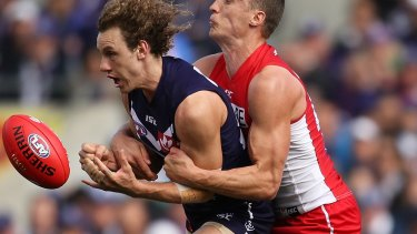 Bruising encounter: Chris Mayne of the Dockers is tackled by Ted Richards.